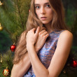 Beautiful girl near christmas tree — Stock Photo #7540076
