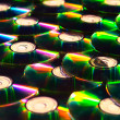 A lot of shiny cd discs lie on each other and shine — Stock Photo