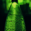Bottle with drops — Stock Photo