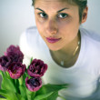 Girl with flowers — Stock Photo