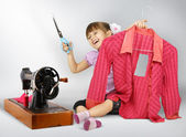 Little girl sewing — Stock Photo