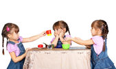 Children playing with plastic tableware — Stock Photo