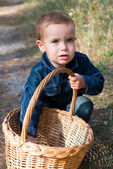 Cute boy and basket — Stock Photo