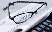 Tax document with calculator and glasses — Stock Photo