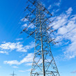 Steel electricity pylon on bright blue sky — Foto Stock