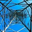 Steel electricity pylon on bright blue sky — Stock Photo