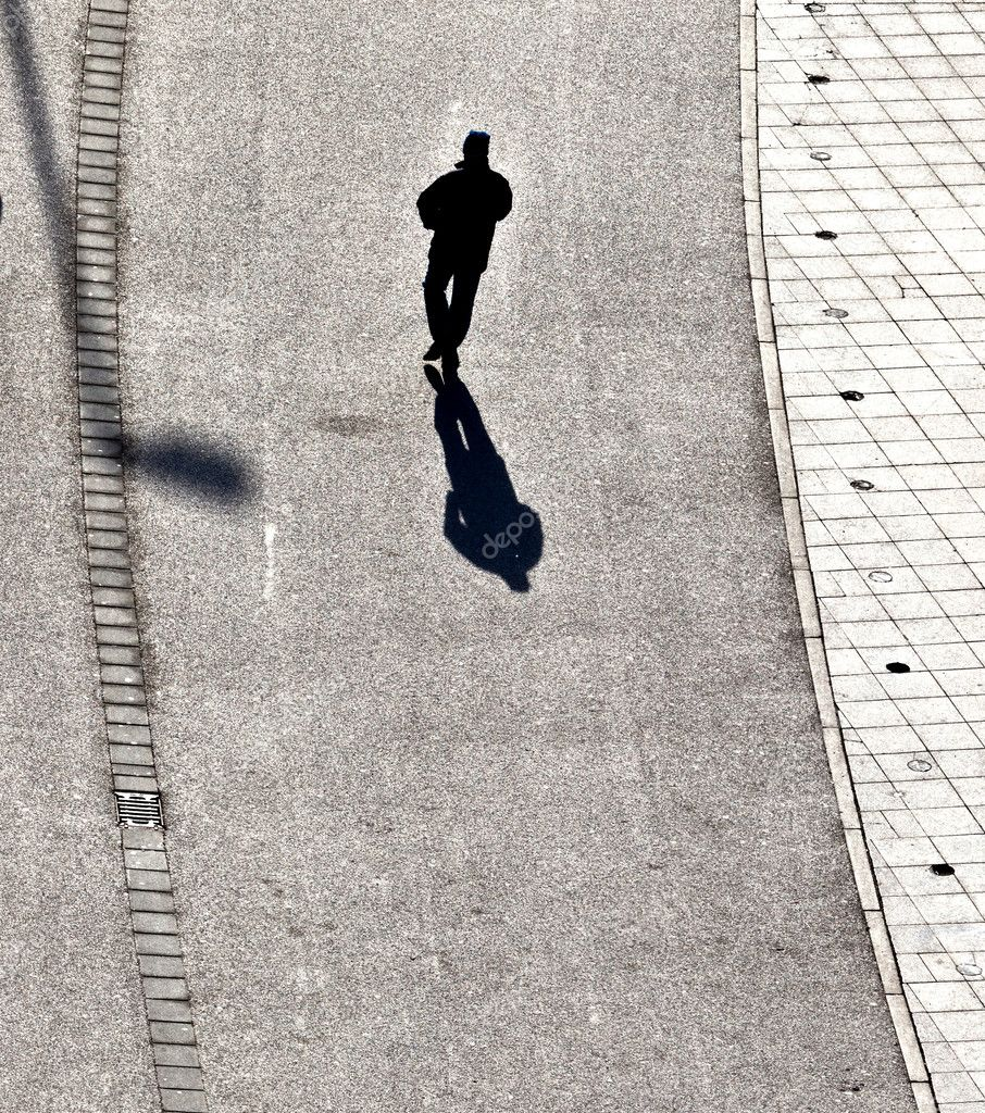 Walking at the street with long shadows — Stock Photo #6752209
