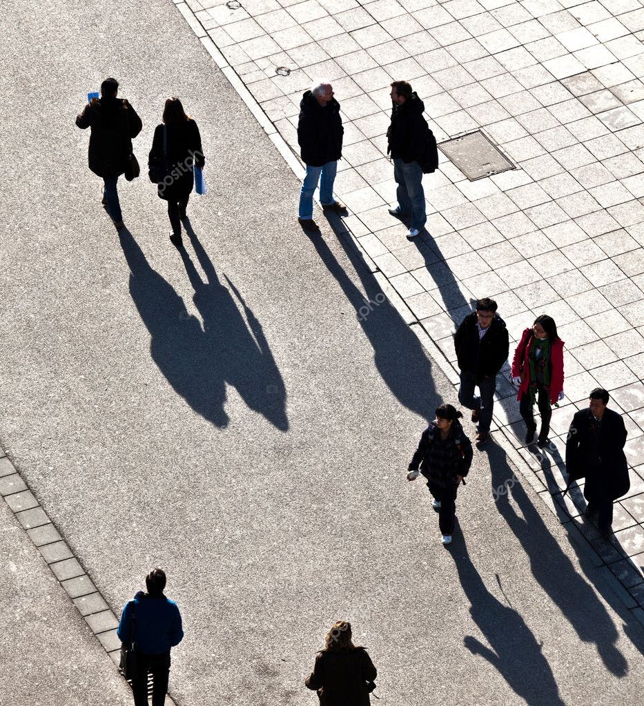 Walking at the street with long shadows — Stock Photo #6752296