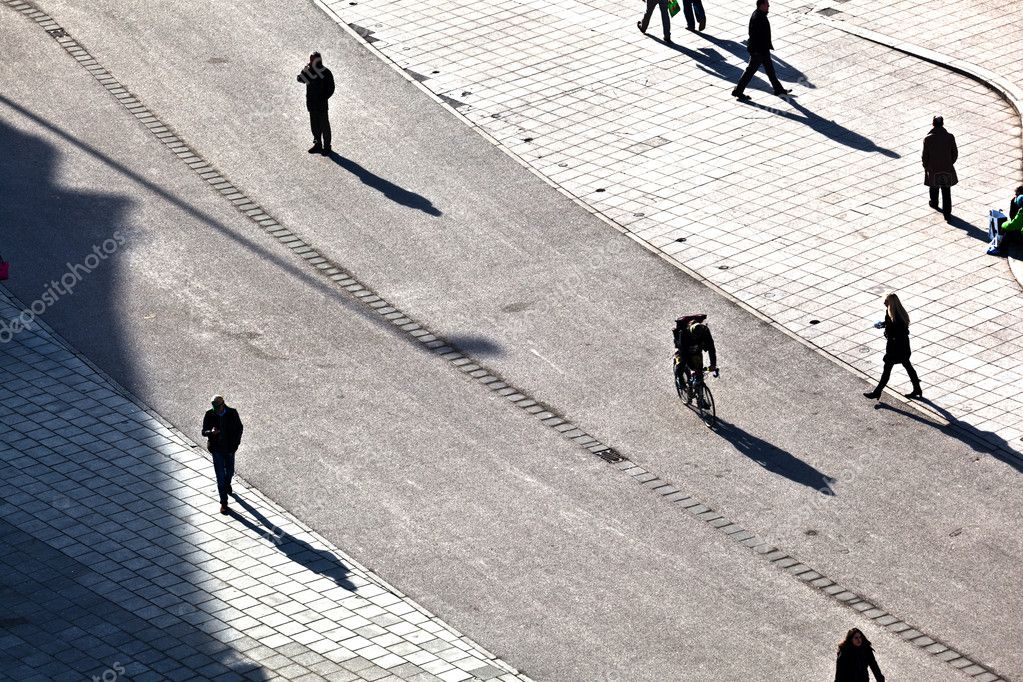 Walking at the street with long shadows — Stock Photo #6752339