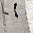 Walking at the street with long shadows — Foto de Stock