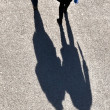 Walking at the street with long shadows — Stock Photo #6762992
