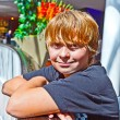 Smiling boy inside a center — Stockfoto