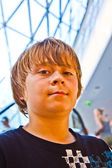 Smiling boy inside a center — Stock Photo