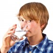 Boy drinking water out of a glass — Stock Photo #6815009
