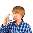 Boy drinking water out of a glass — Stock Photo #6815013
