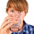 Boy drinking water out of a glass — Stock Photo #6815015