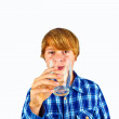 Boy drinking water out of a glass — Stok fotoğraf
