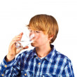 Boy drinking water out of a glass — Stock Photo #6818822