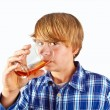 Boy drinking water out of a glass — Foto de Stock