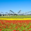 Power plant in beautiful flower meadow — Stock Photo