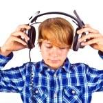 Happy boy with headphones listens to music — Stock Photo #6834435