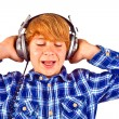 Happy boy with headphones listens to music — Stock Photo #6834999