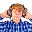 Happy boy with headphones listens to music — Stock Photo #6835627