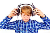 Happy boy with headphones listens to music — Stock Photo