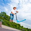 Boy with scooter is going airborne — Stock Photo #6860041