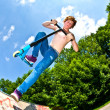 Young boy going airborne with scooter — Stock Photo #6864279