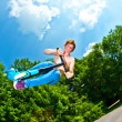 Young boy going airborne with a scooter — Stock Photo #6864751