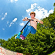 Young boy going airborne with a scooter — Stock Photo #6865784