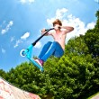 Young boy going airborne with a scooter — Stockfoto