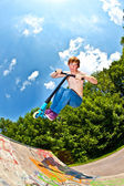 Young boy going airborne with a scooter — Stock Photo