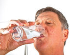 Portrait of attractive man drinking water — Stock Photo