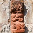 Old medieval stone wall with face of baccus, the god of winery - 图库照片