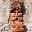 Old medieval stone wall with face of baccus, the god of winery - Stock Photo