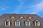 Window in roof with blue sky — Stock Photo