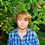 Portrait of cute boy in leaves — Stock Photo #6929824