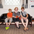 Family sitting on a bench in the Entrance of the Smithonean Muse — Stock Photo