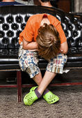 Boy takes a rest at a sofa — Stock Photo
