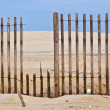 Fence for protection of the dunes at the beautiful natural beach - Stock Photo