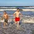 Brothers have fun at the beautiful beach — Stock Photo