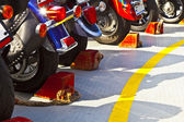 Motor bikes with break shoe at a ferry in a row — Stock Photo