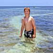 Smart boy loves swimming in the clear ocean — Stock fotografie