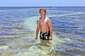 Smart boy loves swimming in the clear ocean — Stock Photo