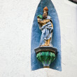Religious figure for protection of the wine in the Rheingau - Stock Photo