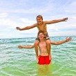 Stock Photo: Boys having fun in beautiful clear sea