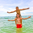 Boys having fun in the beautiful clear sea — Stockfoto
