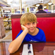 Royalty-Free Stock Photo: Smart boy in a diners at night